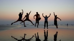 happy-people-jumping-lake1
